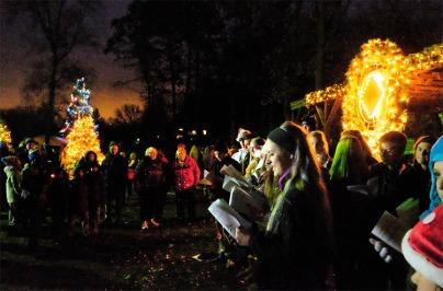 Fort Calhoun junior and senior high show choir members sang Christmas Carols during the annual tree lighting celebration in Market Square Saturday evening.