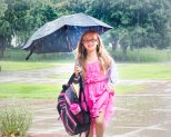Rain shows did not dampen the spirits of this young lady on the first day of school at Arbor Park in August.