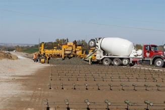 Crews pour concrete on a portion of Highway 133. The summer long detour ended the day before Thanksgiving.