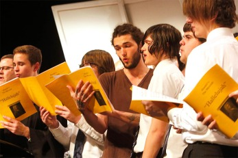 From left: Brian Sandall, Caleb Sandall, Ian Fowler, Eric Curry, Jake Curry, Corbin Patrick, Justus Kucera and many more current and former choir members sing the Hallelujah Chorus from Messiah by G.F. Handel.