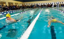 Barracuda team mates Grant Guinan and Gabe Rand finish 1 and 2 in Boys 200 yard Breast Stroke.