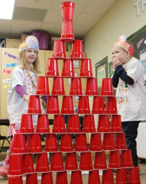 Fort Calhoun kindergarten students celebrate the 100th day of school by counting collecting and stacking 100 items.