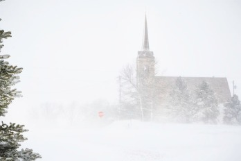 Blowing and drifting snow pretty much closed County Road 9 near St. Paul's ;Lutheran Church Tuesday morning.