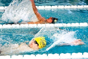 Blair's Blake Stirek, and Gage Graeve, compete in the Boys 100 Yard Back stroke.