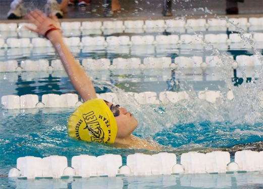 Tucker Cudmore, competes in the Boys 12 and under 50 yard Backstroke.