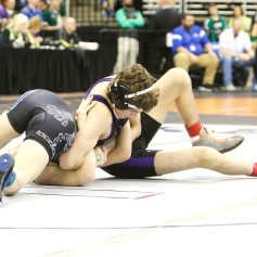 Walker Moore opening round class C 106 pound state championships.