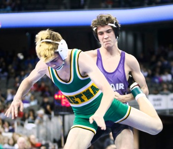 Sophomore Walker Moore work for point against Gretna's Trevor Fauver in lass B 106 pound state championship match at CenturyLink Center in Omaha,Wresting finals