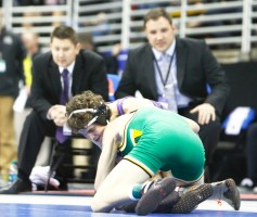Blair coaches Eric Warner and Eric Dolezal watch as sophomore Walker Moore grapples with Gretna's Trevor Fauver in Class B 106 pump state championship match.
