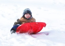 Zayden Gayer gets ready to fly over a mound of snow in Styer Park Wednesday. February 3.