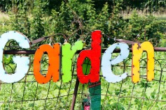 Garden sign on gate at entrance to the vegetable garden.