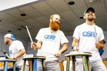 From left Justin Fisher , Chris Sikkema and Josh Smallz Meyer keep the meet during the Omaha Street Percussion performance for Blair Summer Reading Club.