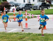 Youth Triathlon Nolan Olson followed by Brooklyn Schroeter and Alayna Brown race to the finish line.