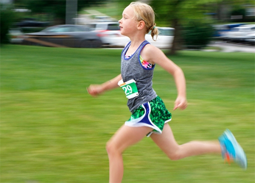 Taytum Macholan glides down Butler street during the Tri at the Y.