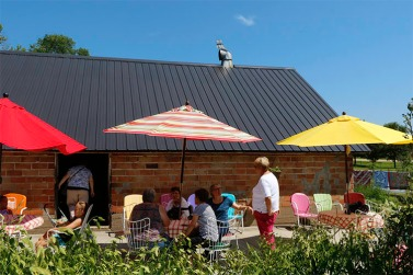Umbrellas provide shade while visitors enjoy refreshments