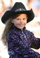 Alexia Cruckshank rides in Friday night rodeo opening ceremony.