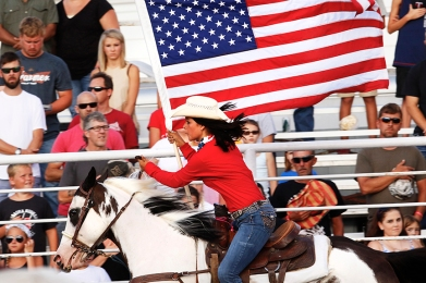 Bailey Stoddard carries the colors Sturday evening at WCF Rodeo