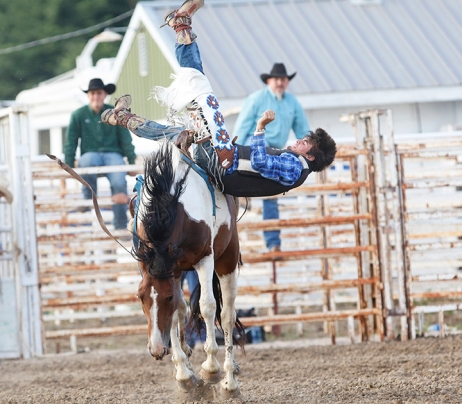 Bareback rider Chase Corgin Saturday night rodeo,