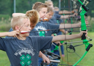 Gabe Flynn takes aim during the Washington County 4H Archery competition Saturday at the Washington County Fair grounds at Arlington