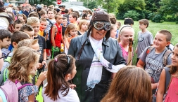 Marit Leishman in costume greets students on the opening morning of Fort Calhoun Elementary School.