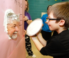 "Becket Scott pies Steve Ray . The student in each classroom that raised the most money earned a chance to ""PIE"" a teacher. Students names were also drawn in a raffle to Pie staff members."