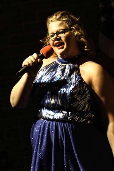 """Noel Thielen and Innovation belts out """"The House is Rockin' """" with the Innovation show choir t the Blair Show Choir Workshop 2017."""