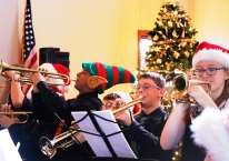 Trumpets, from left Brad Tonn (with elf hat), Garrett Bonham, Cameron Babbitt, Olivia Fitchhorn Otte Jazz Band at Good Shepherd