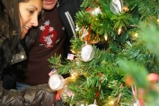 Guy and Anna Barta view one of three Veterans Christmas tree at Goldies in Fort Calhoun Each clear ornament contains the name and picture of Washington County veteran. Both Guy and Anna are Navy veterans.