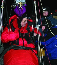 Ground crew checks harness as Jaworski prepares for a long distance flight in February, 2006.