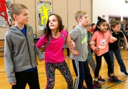 Third grade students move with the music