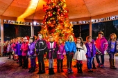 Girl Scouts circle the Christmas tree and sing carols during the Fort Calhoun Christmas Tree Lighting in Market Square.