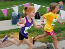 From left, Abbi Vakiner and Lainey Smoyer Smoyer sprint toward the finish line.