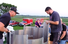 Trainer Craig Berg and John DiGiorgio assemble rescue tube in grain wagon on Dunklau Dairy Farm.