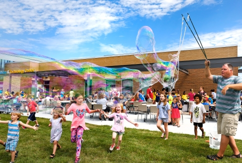 Dr. Oxygen, far right, entertains kids with giant soap bubbles at the Blair Library Reading party. A free picnic lunch followed the awards presentation and Dr. Oxygen science show.