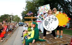 Christina Bowser holding moon and Tess Rutledge with the sun and FC elementary teachers arrive at school dressed in costume and ready to celebrate space, the eclipse and launch an exciting new school year.