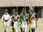 Members of the Sixth Infantry and the 1st Rifle Regiment march in formation during the Independence Day celebration Saturday. Fort Atkinson Living History July 1