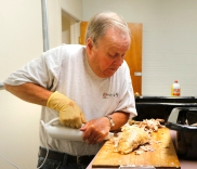 Bruce Will slices turkey bread with electric knife. St Mary's Church Turkey dinner