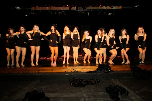 """Jenna Carlson (Adelaide) and Hot Box girls rehearse a dance scene from """"Guys and Dolls."""""""