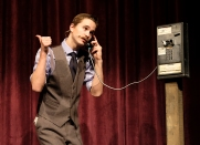 Nathan Detroit played by Caleb Sandall talks on the phone to Joey trying to set up a craps game.