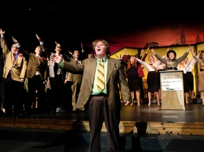 """Nicely-Nicely Johnson played by Andrew Sorenson sing """"Sit Down Your Rocking' the Boat"""" during a rehearsal."""