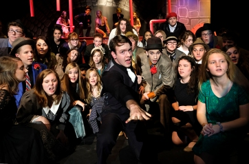 """Sky Masterson, played by Mitchell Guynan, rolls the dice during """"Luck Be a Lady """" in the Blair High Schools production of """"Guys and Dolls."""""""