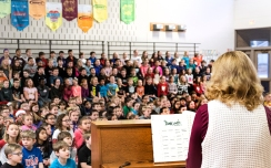 Music teacher Kay Dickinson plays piano and leads Arbor Park students and teachers in an all-school sing along Thursday morning.