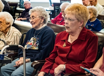 From left Elaine Larson and Vivian Storjohann sing along with the Otte Show Choir at Carter House.