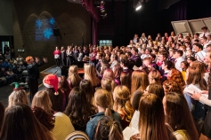 Denise Luke leads alumni and combined choirs in the traditional performance of th Hallelujah chorus during the Winter Vocal Music concert.