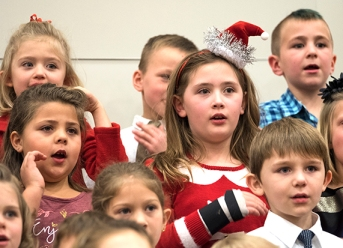 FC K - 6 Holiday Concert Front Row from left: Anabelle Bochnicek, Camryn Reynoldson. Second Row, left to right: Madison Bach, Addison Hemphill. Third Row, left to right: Audrey Barthel, Oliver Geiger, Frank Bonacci
