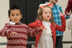 Axton Gutierrez and Camryn Christensen and Fort Calhoun kindergarten students sing Winter Wiggles at the 2017 Winter Program,