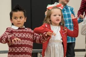 Axton Gutierrez and Camryn Christensen and Fort Calhoun kindergarten students sing Winter Wiggles at the 2017 Winter Program,