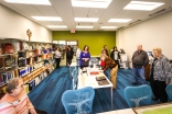 Visitors gather in Genealogy room. Blair Library Grand Opening