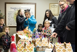 Visitors vote for their favorite Gingerbread Houses during the Gingerbread House Contest at the Fort Calhoun American Legion Hall.