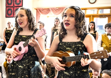 From left Breanna Matzen and Mary Garcia play the ukulele and sing Silent Night at Shepherd Village Tuesday.