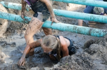 Hannah Hicks keeps her head out of the mud while crawling through the muddy trench Washington County Fair Saturday AM